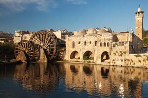 Колёса Нориас — древнейшие водоподьемные механизмы, которыми знаменит город Хама.