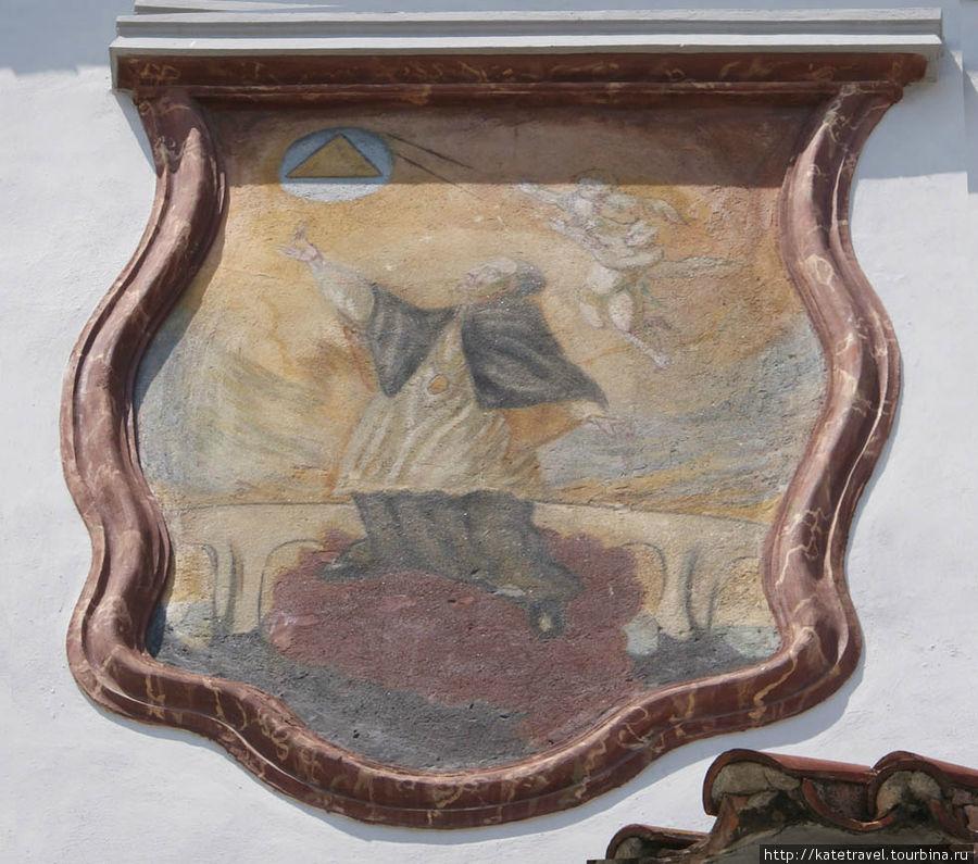 Настенное изображение Яна Непомуцкого. Площадь Согласия, дом №14