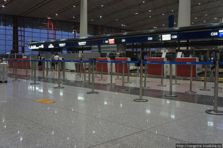 Пекинский аэропорт. Стойка регистрации.