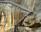 Современному человеку подъем на вершину облегчает металлическая лестница. В древности же человек мог попасть на скалу, поднявшись по высеченным в ней ступеням. Они проходят чуть ниже современных