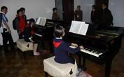 18.  Класс игры на рояле в восемь рук. Абсолютное единство со сменой играющих в процессе исполнения
