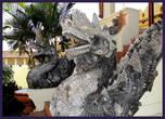 Облик нага   легко узнаваем по длинному изогнутому телу змеи и драконьей голове с хохолком, напоминающим то языки пламени.    Наги считаются почитателями учения Будды. Один из них — царь-нага Мучалинда — спас  Будду во время наводнения, подняв его на кольцах своего тела и раскрыв над ним змеиные капюшоны