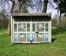 Въездные деревянные ворота во Флёнове, изготовленные по сохранившимся  эскизам художника С.В. Малютина (конец XIX века) в 2005 году