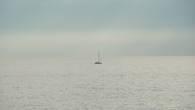 Одинокий кораблик гдето вдали.