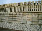 На каждом кирпичике и столбике написаны имена спонсоров храма