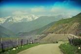 ..то появятся на горизонте белоснежные шапки-ушанки далеких гор..